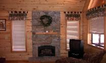 Fireplace in Heber Overgaard Real Estate Investment Cabin, across from Bison Ranch